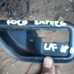 1989 ford sapphire left front inner door handle surround - used
